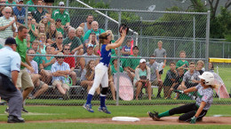 Yorktown's Lexie Robertson safely stretches her hit into a triple.