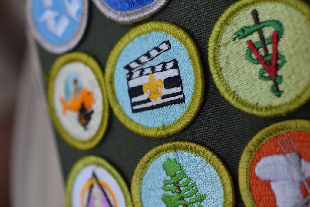 A few of the 137 merit badges on Charlie Murphy's sash.