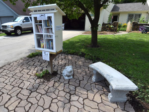 "Seating area by the ""Little Free Library."""