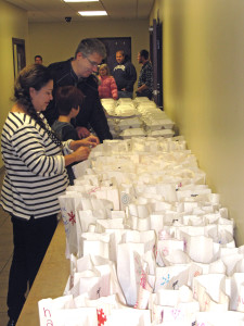 Volunteers preparing food to be delivered to those who are home bound. Photo provided.