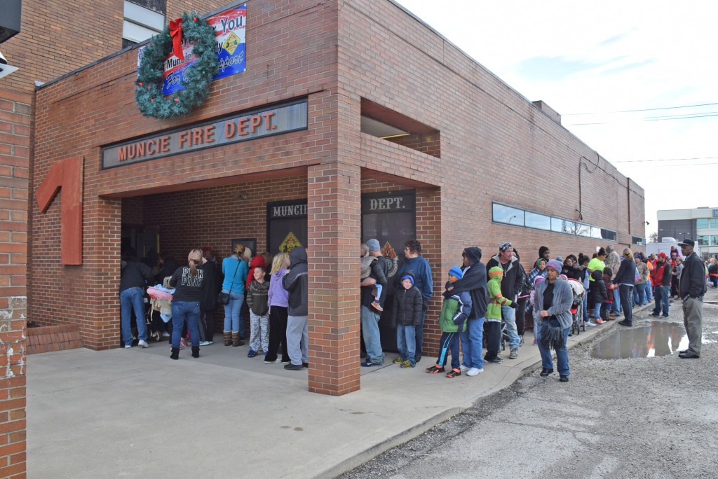 The line to see Santa wrapped around the fire station at last year's event. File photo.