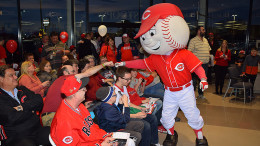 Fist bump at the Reds Caravan held at Stoops Automotive in 2017. Photo by: Mike Rhodes