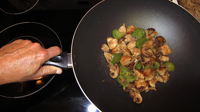 Culinary science proves that food cooked in woks automatically turns into moo goo gai pan. Photo by: Nancy Carlson