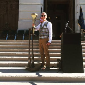 Dale Basham tries out the 4.5 lb. torch for the upcoming Torch Relay. Photo provided.