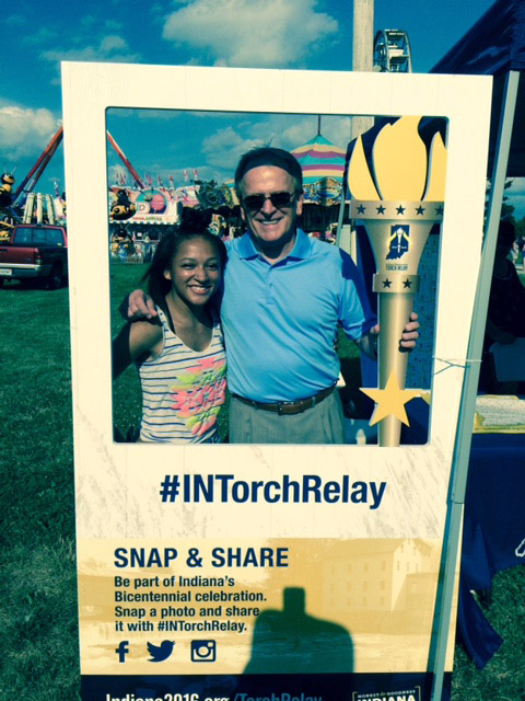 "Torch Bearers Delyn Harty-Isom and Mayor Dennis Tyler take a ""selfie"" at the Torch on Tour booth at the Delaware County Fair. Photo by: Nancy Carlson"