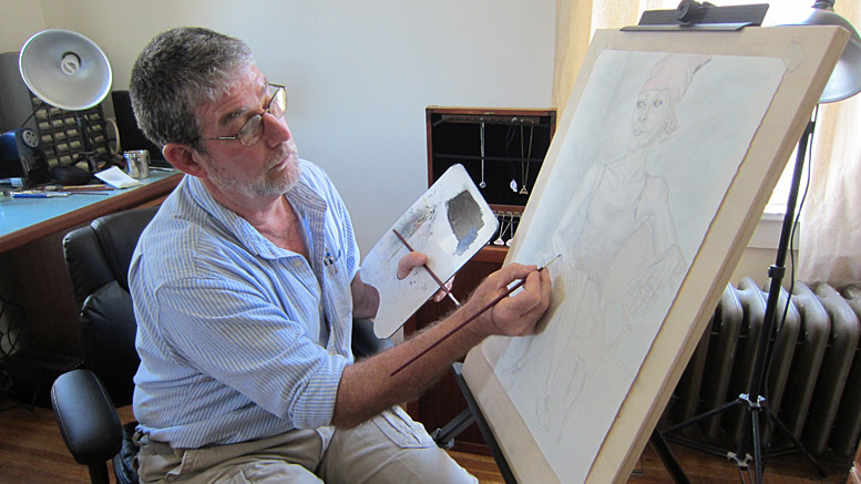 Artist Allan LaBerteaux works on the portrait of a lady named Destry. Photo by: John Carlson