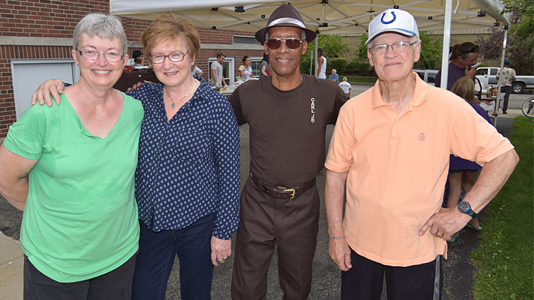 Pictured L-R: Loretta Parsons, Executive Director; Garnet Wince, Founder of Harvest Soup Kitchen; Carl Kizer, Jr.; Leland Wince, MD. Photo by: Mike Rhodes