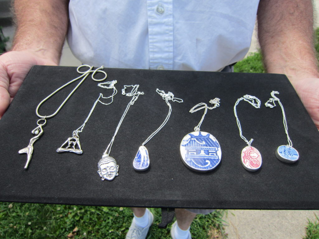 "Allan LaBerteaux's jewelry includes necklaces celebrating yoga (far left), and the type called ""Chaney,"" which employs pieces of china (three on the right). Photo by: John Carlson"