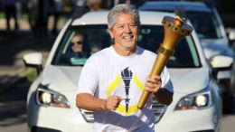 Indiana Bicentennial Torch Relay in Delaware County. Jeff Bird carries the torch. Photo by: Sadie Lebo