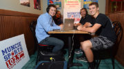 Muncie's Sports Station's Mark Forester and Cliff Johnson are shown as they broadcast live from Mancino's in Muncie, during the High School Football Sectional Preview show. Photo by: Mike Rhodes