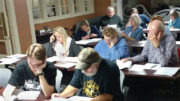 Volunteer tutors study during the new tutor orientation, held in downtown Muncie's CO:Lab. Photo provided.