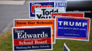 Candidate signs displayed outside of Precinct 50. Photo by: Mike Rhodes