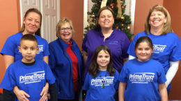 PrimeTrust Federal Credit Union employees and their children deliver holiday cards and carol at Signature HealthCARE of Muncie. Photo provided.