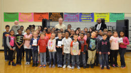 Kiwanis Club members and students are pictured with their new dictionaries. Photo provided.
