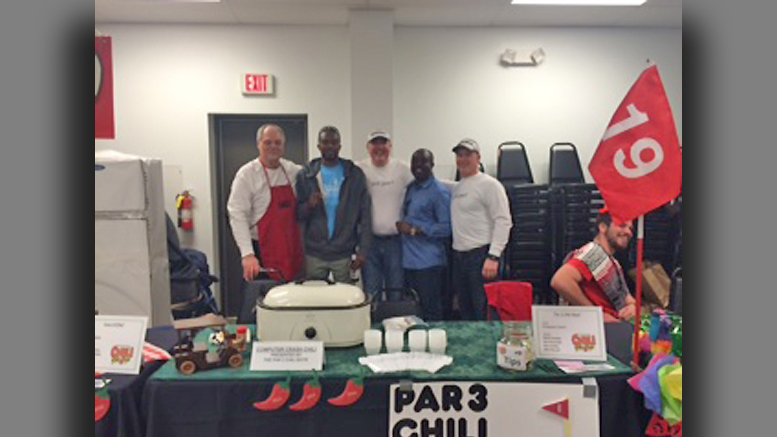 """The Par 3 Chili Boys"" pose with visitors from Haiti. L-R Mark Flodder, Assene Guibert (Library Manager in Haiti), Ray Conley, Rev. Pedro Gaguerre (Pastor at St. Michael's in Haiti) and Wes Russell. The name of their chili was ""Computer Crash."" (Turns out that one of their secret ingredients was Spam.) Photo by: Carole Clohessy"