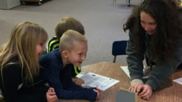 A teacher works with her students in the classroom. Photo provided.