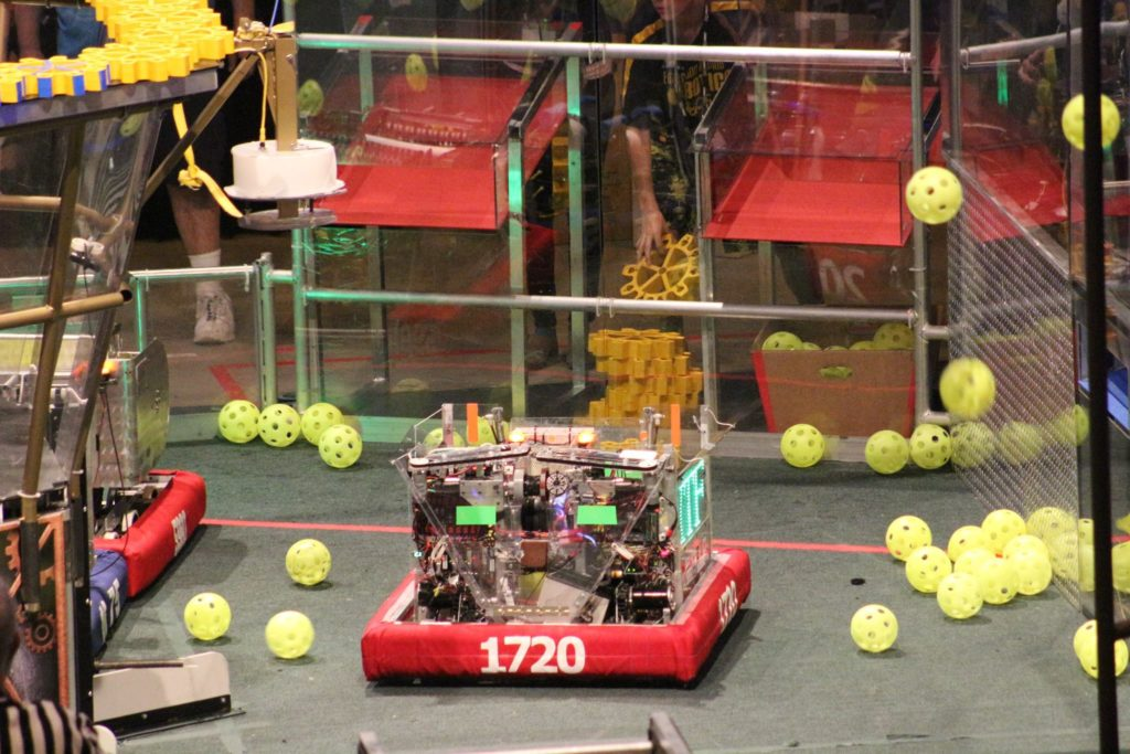 "PhyXTGear's robot, ""Spitfire"" moves down the field after picking up a gear during a match. Photo provided."