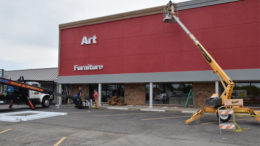 Signage installers and painters working at the new Art Van Furniture location in Muncie.