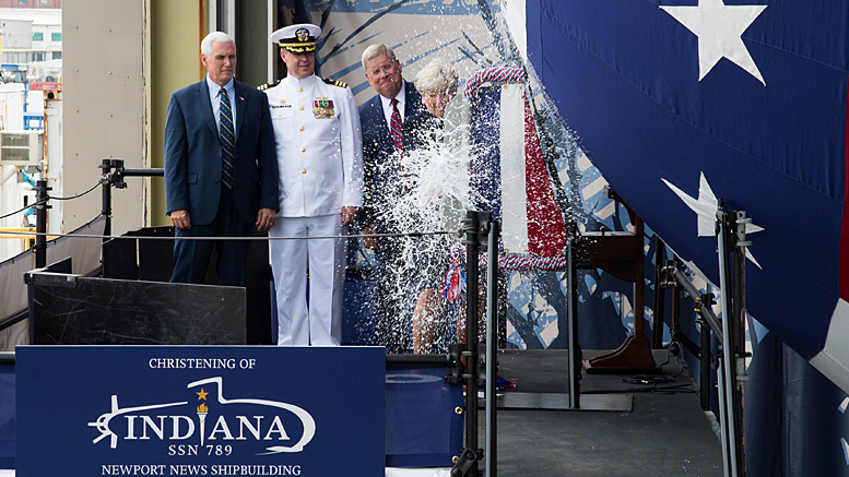 Ship's Sponsor Diane Donald christens the Virginia-class attack submarine Indiana (SSN 789), witnessed by, from left, Vice President Mike Pence, Cmdr. Jesse Zimbauer, Indiana's commanding officer, and Newport News Shipbuilding President Matt Mulherin. (U.S. Navy photo courtesy Huntington Ingalls Industries by Ashley Major/Released)