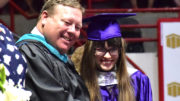 MCHS Principal Chris Walker is pictured with Kaitlyn Jamieson accepting her diploma. Photo by: Mike Rhodes