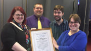 From left to right: MPL employees Rebecca Parker, Dan Allen, and Stuart Cotton pose with Brandi Scardilli, award presenter and an editor at Information Today, Inc. Photo by: Mary Lou Gentis, Muncie Public Library