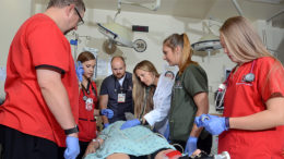 Dr. Kendal Baker and the Emergency Department team review trauma patient care. Photo courtesy of IU Health/Ball Memorial Hospital.