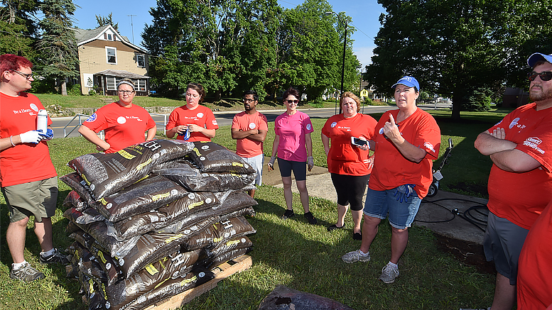 Volunteers from Lowe's have a brief meeting before starting their work on June 22nd at the Boys & Girls Club of Muncie. Photo by: Mike Rhodes
