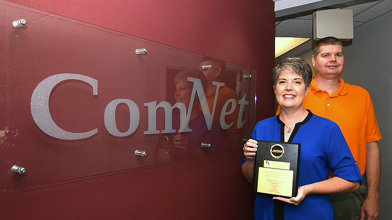 ComNet owners, Mindy and Tom Kemper are pictured with their 13th ATSI award. Photo by: Mike Rhodes