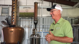 My Uncle Jim explains the whiskey distilling process. Photo by: Nancy Carlson