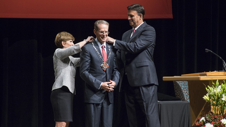 Renae Conley (L) Vice Chair, Board of Trustees and Richard Hall (R), Chair, Board of Trustees present the University Medallion to Geoffrey S. Mearns,(C) Ball State's 17th President. Photo by: Mike Rhodes