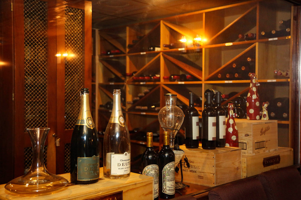 Vera Mae's wine cellar houses a large selection of wines from around the globe, for tastes to suit everyone from robust Cabernets to crisp Rieslings. Photo by: Lorri Markum