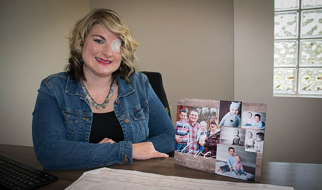 Brittani Richards is pictured in her Thrive Credit Union office with photos of her family. Photo by: Mike Rhodes