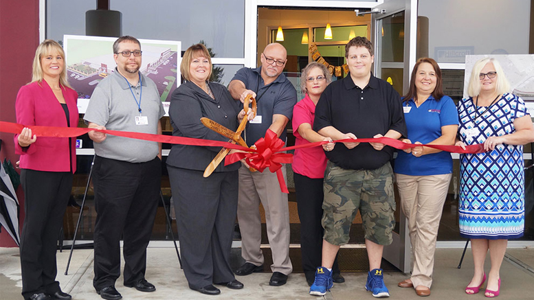 Pictured Left to Right: Brenda Lloyd, Hillcroft Services Board Chair; Michael Whitlock, Hillcroft Industries, VP Business Operations; Debbie Bennett, Hillcroft Services, CEO; Mike Salmon, Hillcroft Industries, VP Business Development; Melissa Johnson, Hillcroft Industries, Production Coordinator; Jacob Sloan, Hillcroft Industries Employee; Amanda Rammel, Hillcroft Industries, Manager;  LeAnne Cole, Hillcroft Services, VP. Photo by: Matt Howell, Farmhouse Creative.