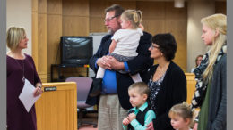 A family adoption is finalized on November 17th in the Delaware County Justice Center. Photo by: Jeneca Zody