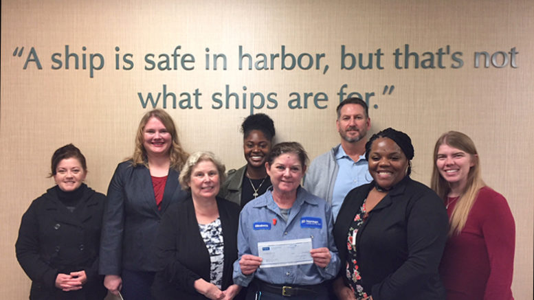 Photo (left to right): Kimberly Gruesbeck, Sana Szewczyk, Zenee Gadson, Elizabeth Covington (presenting the check), Simon Martin. Representing Second Harvest are: Karen McTague, Dorica Watson and Alex Sheward.
