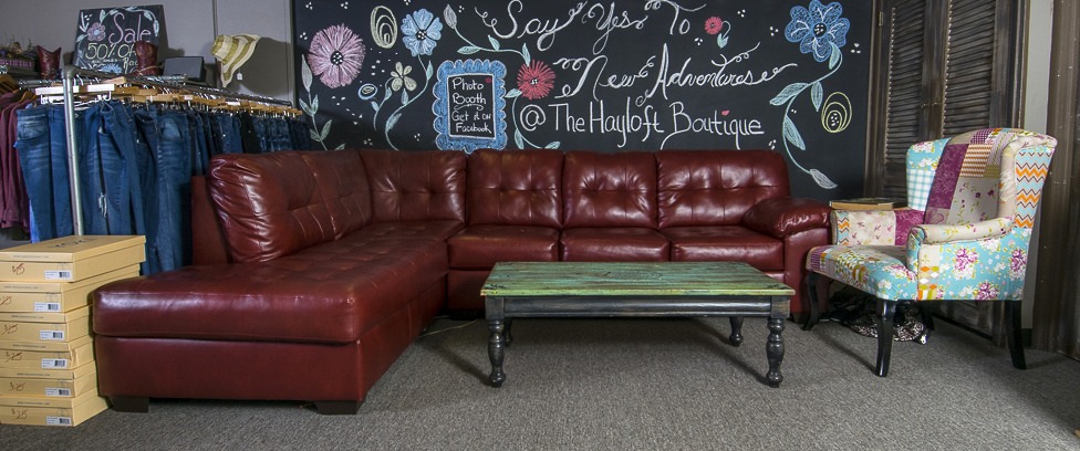 The ultra-comfortable sofa is just outside the fitting rooms, making it a favorite place for husbands to hang-out, too.