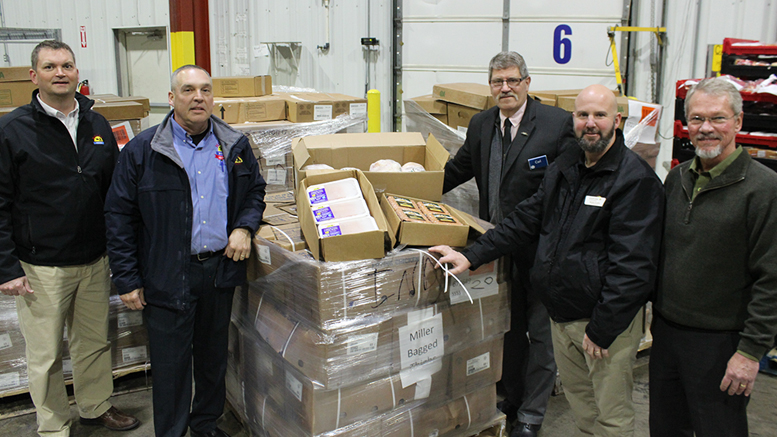 Representatives from Miller Amish Poultry, Second Harvest, and the new PayLess store gather to receive a donation of 6,800 pounds of poultry from Kroger stores. Left to right: Fred Lechlitner and Ken Rains, Miller Amish Poultry; Carl Vermilyer, Kroger; Barry Floyd, Empire; and Tim Kean, Second Harvest.