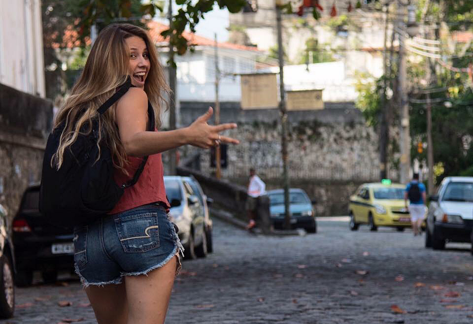 Grace Hollars smiles and waves in the streets of Rio during her trip to cover the 2016 Summer Olympic Games. Photo provided
