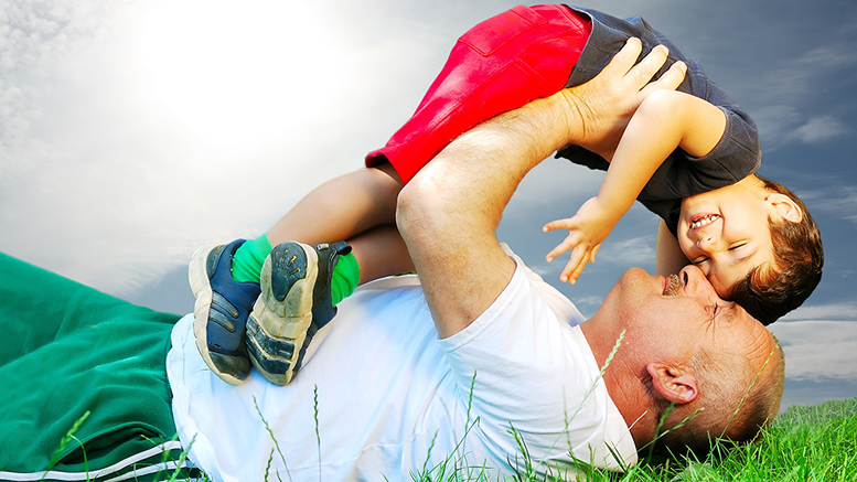 A father and son enjoying quality parenting time. By: graphicstock