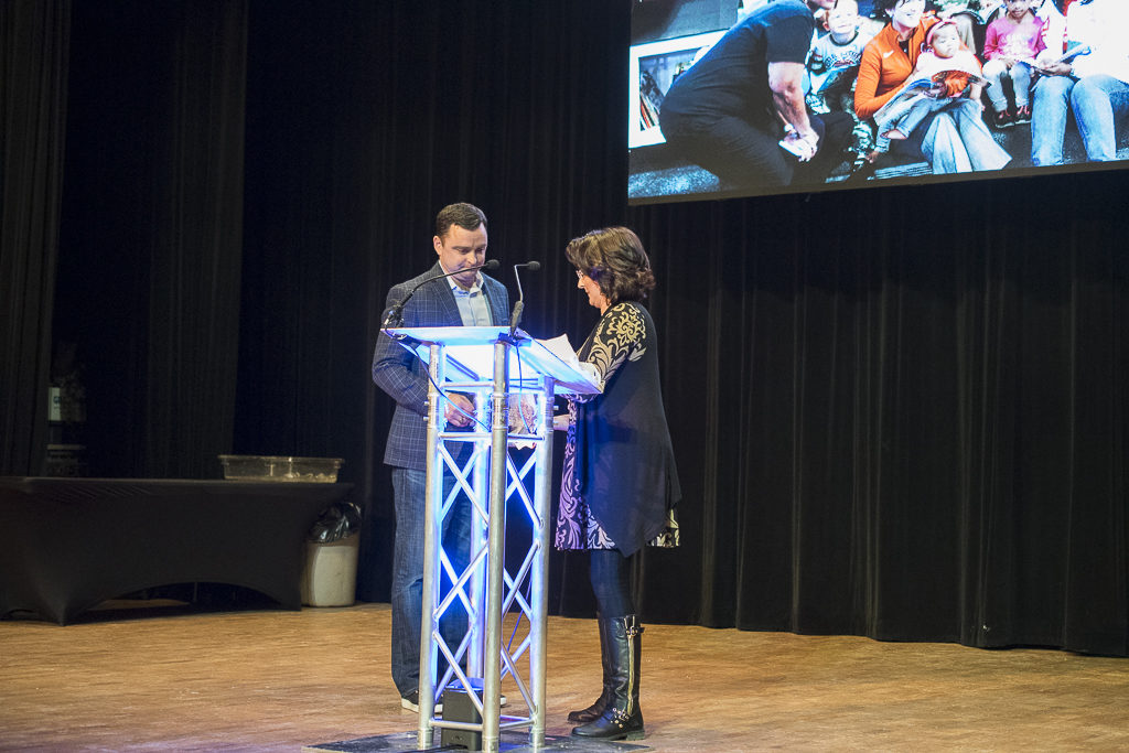 Jenni Marsh prepares to present Casey Stanley with the award at the 2017 Campaign Celebration. Photo by: Mike Rhodes