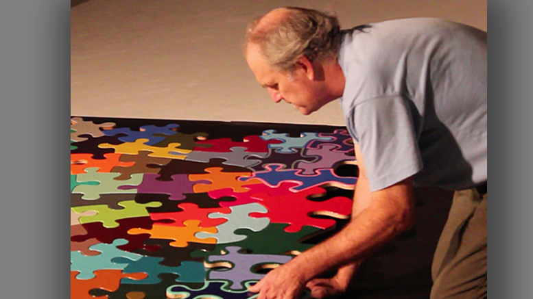 "Artist Kevin Campbell is pictured with his ""Puzzle Project."" Photo provided."