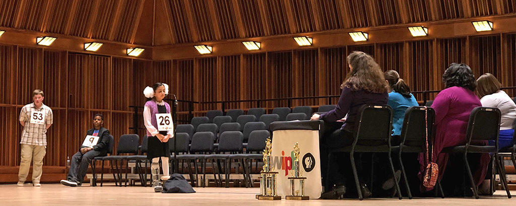 Burris Laboratory School student Alesya Rathinasamy, at the microphone spelling a word, is the winner of the third WIPB-TV Spelling Bee. Photo provided.