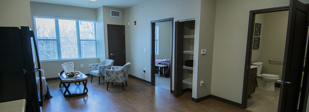 Sample one bedroom unit with kitchenette, storage areas, hardwood flooring and large bathroom. Photo by: Mike Rhodes