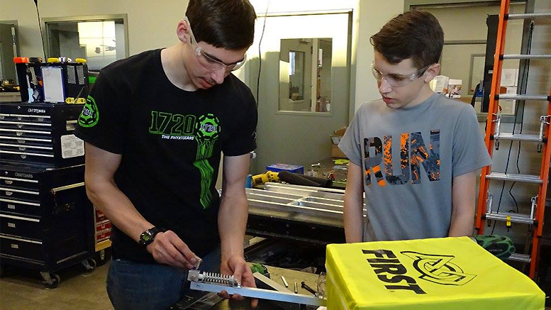 PhyXTGears team members work on parts for the team's robot during build season. Photo provided.