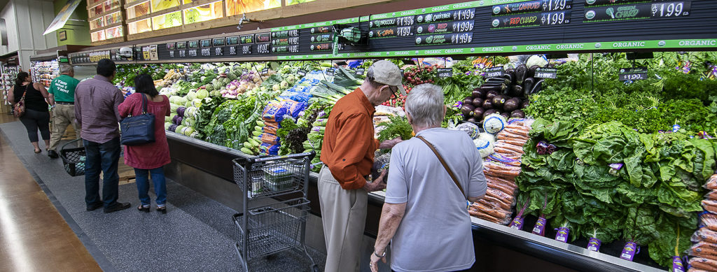 Shoppers check out some of the produce options during opening day. Photo by: Mike Rhodes