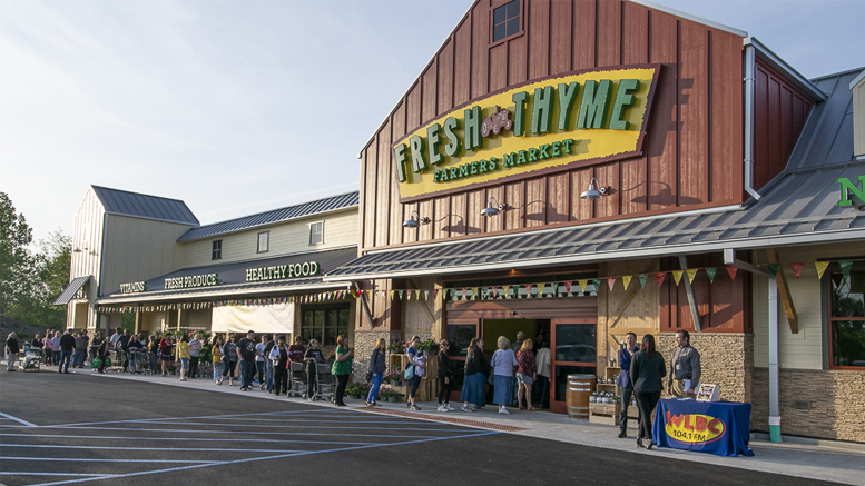 Early shoppers are pictured outside the new Fresh Thyme Farmers Market at 7am, May 17th. Photo by: Mike Rhodes