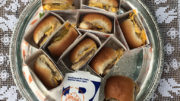 White Castle sliders fill a silver serving tray. Photo by: Nancy Carlson