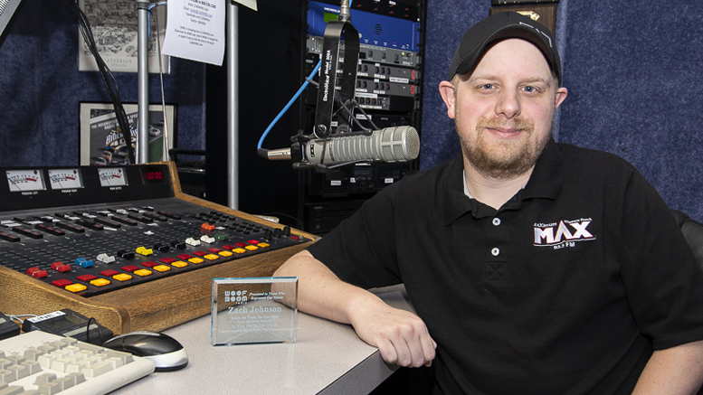 Zach Johnson is pictured in the studio with his award. Photo by: Mike Rhodes