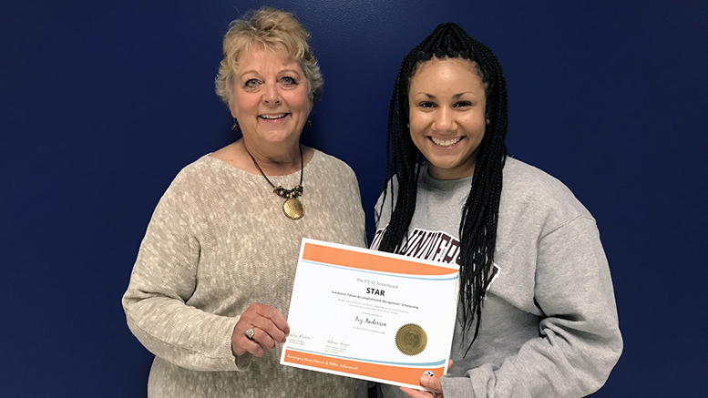 Ivy (R) is pictured receiving her STAR scholarship certificate from P.E.O Cathy Stewart (L) on May 17 at Burris High School. Photo provided.