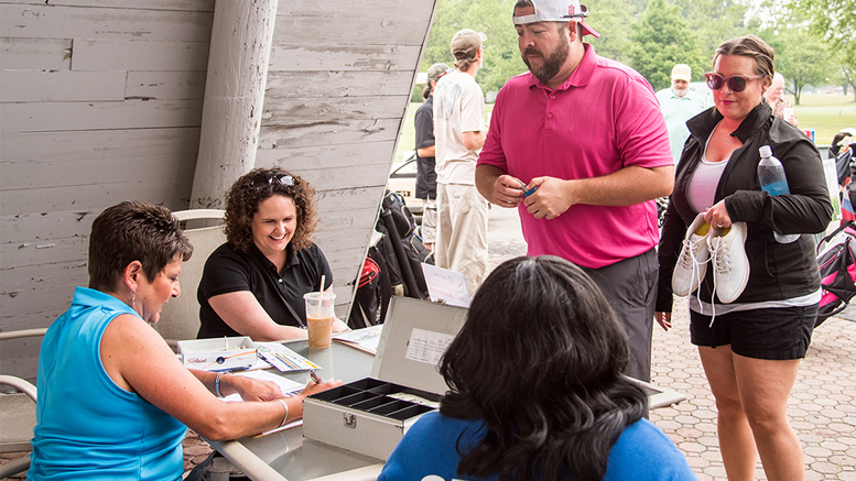 Golfers arrived early on June 10th to check in with Hollie Partin, Sara Shade, and Qiana Clemens. Photo provided.